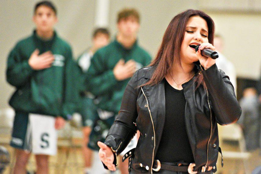 American Idol finalist Madison VanDenburg sings the National Anthem last week at Mohonasen High School.