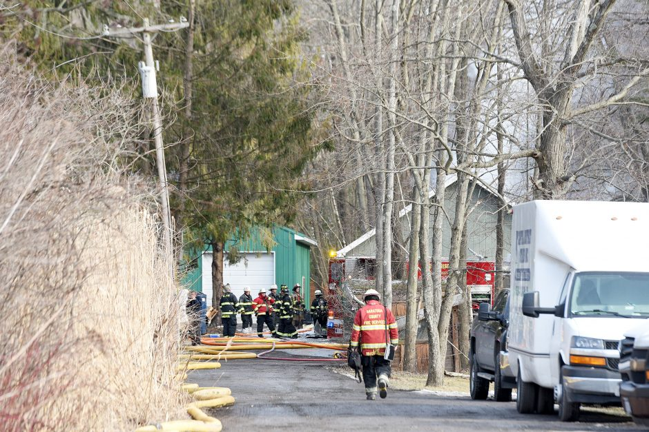 Firefighters and investigators respond to a structure fire at 45 Dunsbach Road in Halfmoon Wednesday.