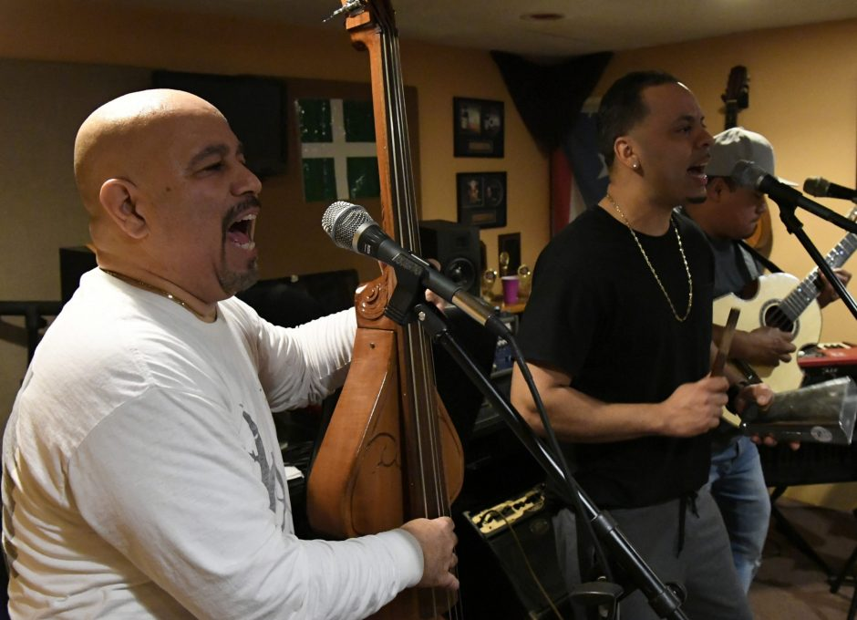 Alex Torres & His Latin Orchestra rehearse last week at Torres' home in Scotia.