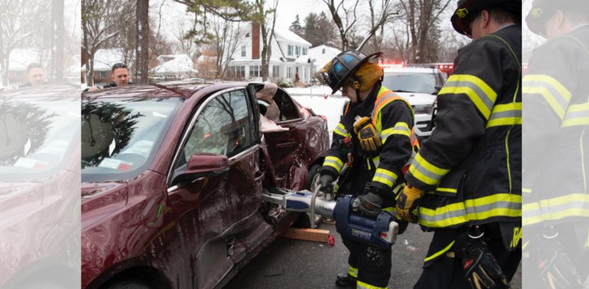 Niskayuna District 1 firefighters use the Jaws of Life Sunday to free a driver at Nott and Dean Streets