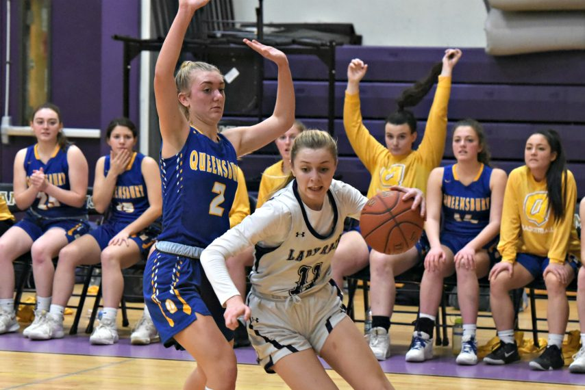 Amsterdam's Andie Gannon drives to the basket against Queensbury.