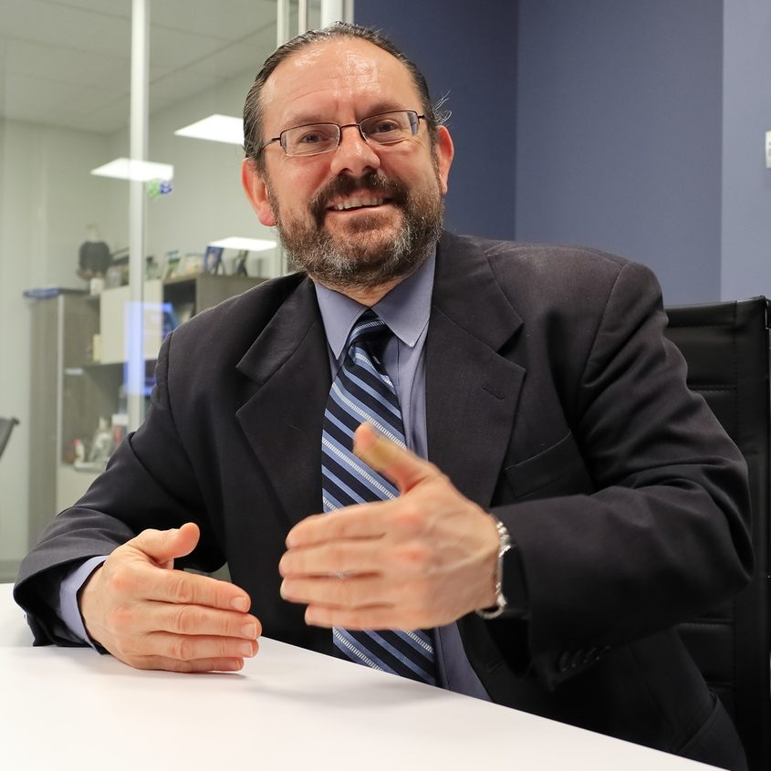 LogicalNet CEO Tush Nikollaj is shown in his Schenectady office.