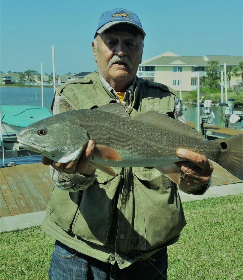 Daily Gazette outdoors columnist Ed Noonan displays the first red fish he caught and released in the intercostal waterway.
