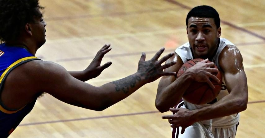 Nacier Hundley, right, scored 27 points in Bishop Gibbons' win Tuesday.
