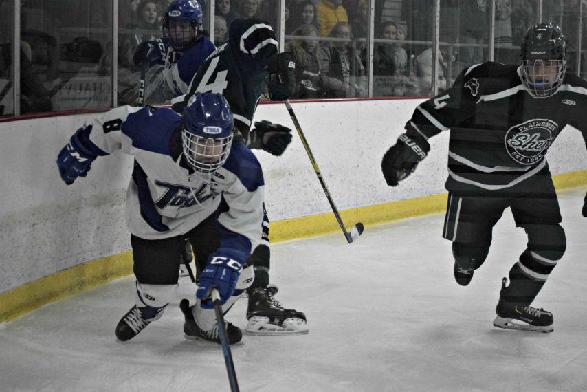 Saratoga Springs' Mack Ogden, left, chases down a loose puck during Wednesday's game against Shenendehowa.