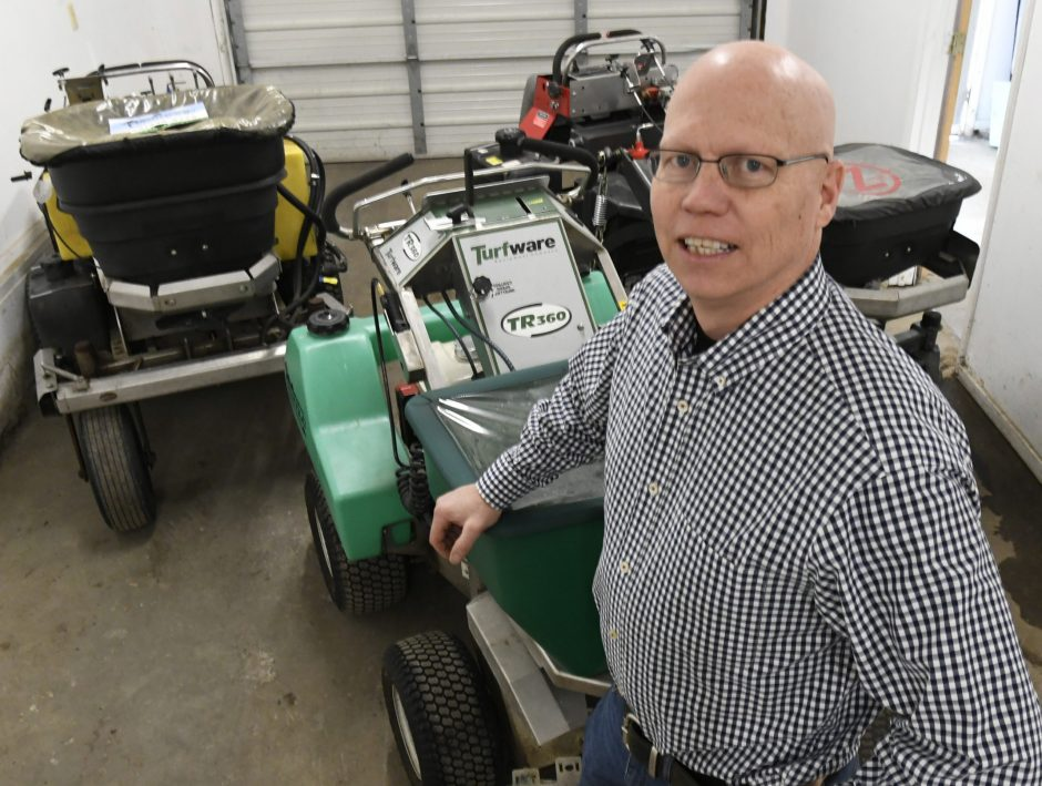 Tim Brennan, owner of Brennan Landscaping in Schenectady, stands with several different landscaping machines, January 29, 2020.