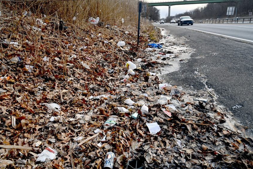 Plastic bags and other litter are strewn along Interstate 890 in Schenectady in this 2019 image.