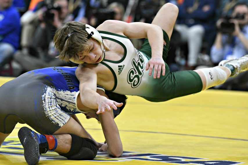 Shenendehowa's Stevo Poulin, right, won his third state wrestling title Saturday.