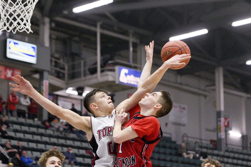 Fort Plain's Joe Lemoine, left, blocks a shot by Waterford's Evan Fairclough on Tuesday in the Class C semifinals.