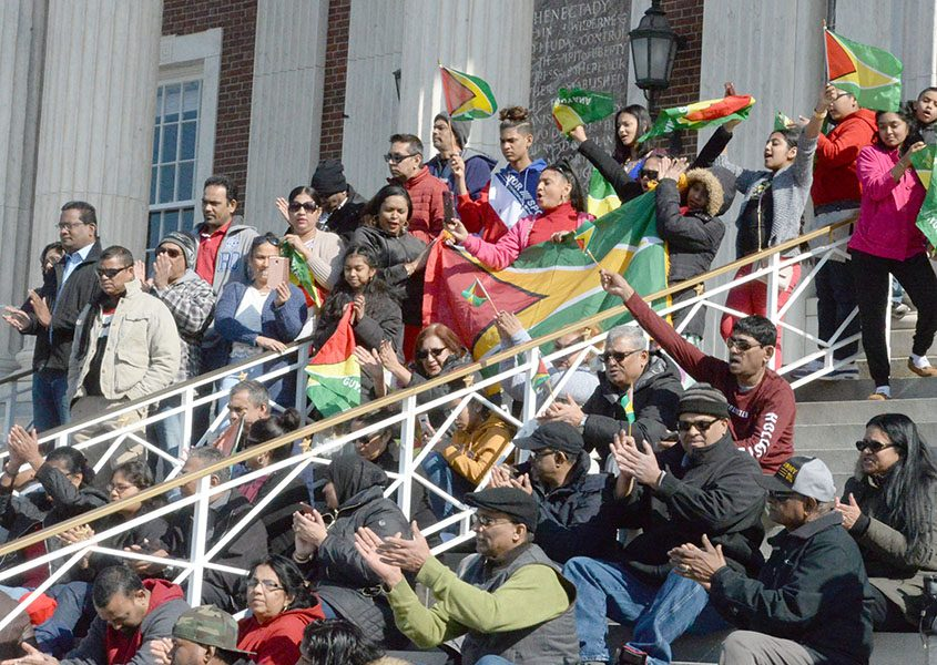 Schenectady's Guyanese community gathered at City Hall to protest recent national elections.