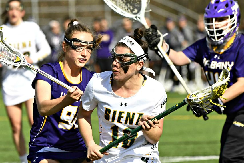 Siena's Nicole McNeely moves through the UAlbany defense during a women's lacrosse game Wednesday at Hickey Field.