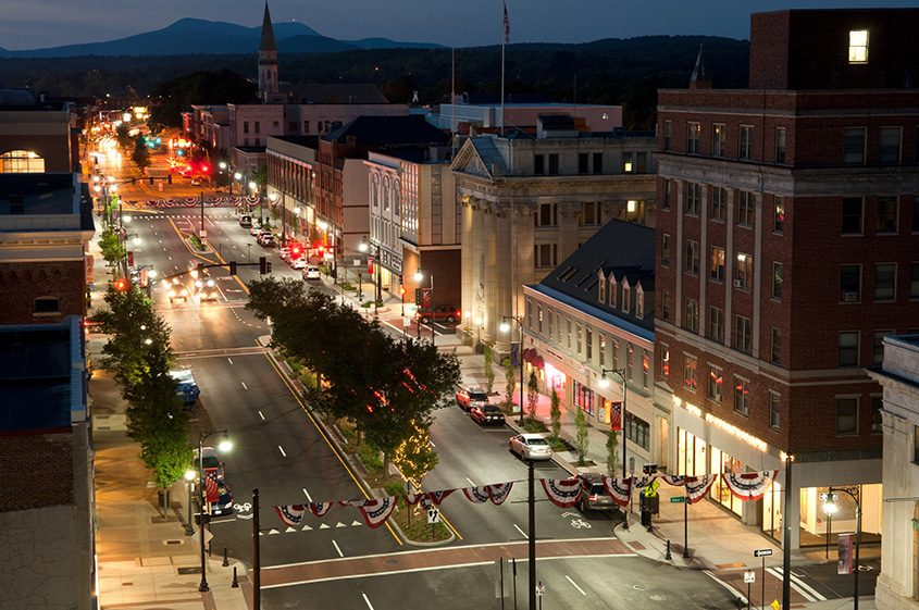 Downtown Pittsfield is shown at dusk.