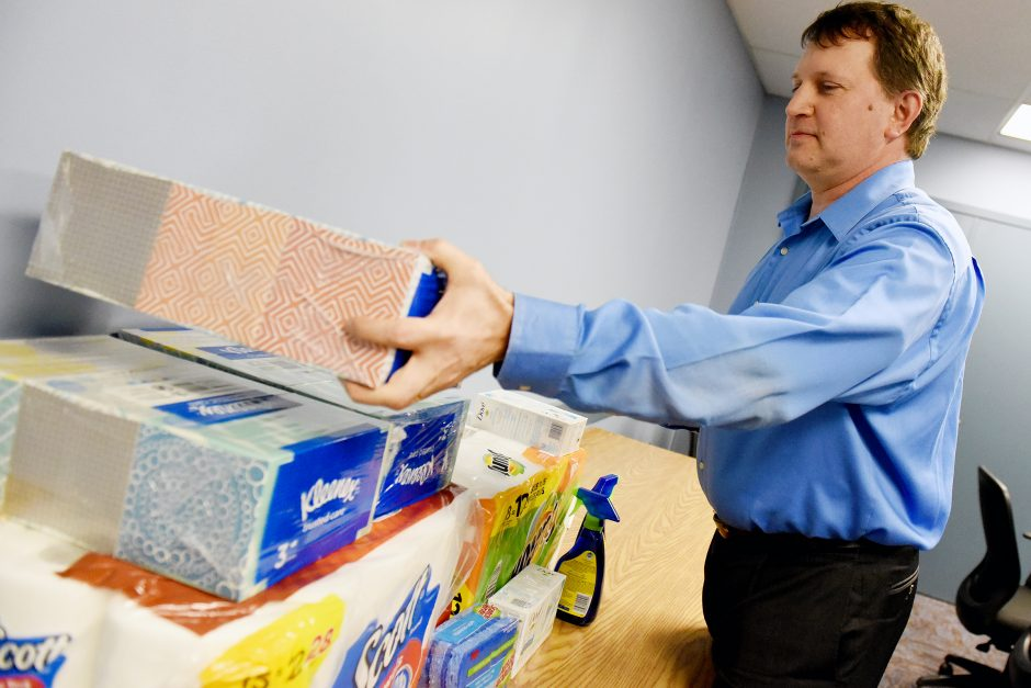 Glenville Town Comptroller Jason Cuthbert organizes donations for seniors at Town Hall Monday.