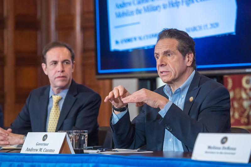 Gov. Andrew Cuomo, right, speaks about the COVID-19 crisis.