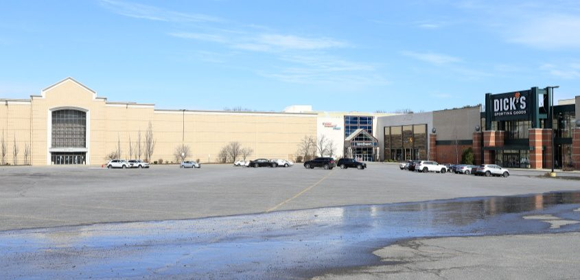 A nearly deserted Crossgates Mall parking lot Wednesday afternoon