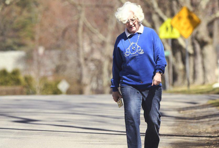 Mary Matz of Niskayuna takes a stroll on Niskayuna Drive Friday.