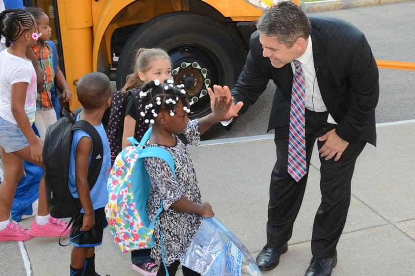 Schenectady School District Superintendent Larry Spring gives students high fives before they enter Howe Elementary in 2015