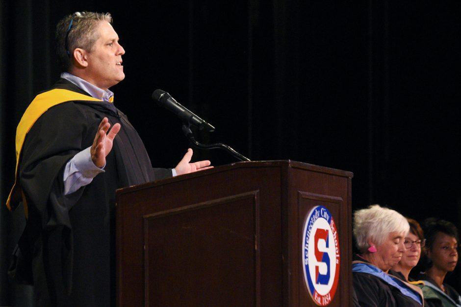 Former SHS Superintendent Larry Spring speaks during the summer high school graduation at Schenectady High School last August.