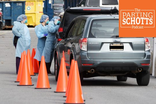 Nurses tend to patients during a drive-thru testing tent for coronavirus outside Saratoga Hospital on Wednesday.