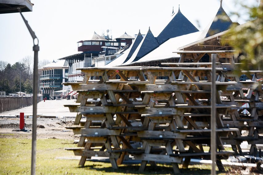Stacks of picnic tables sit next to the grandstand turn at Saratoga Race Course on Friday.