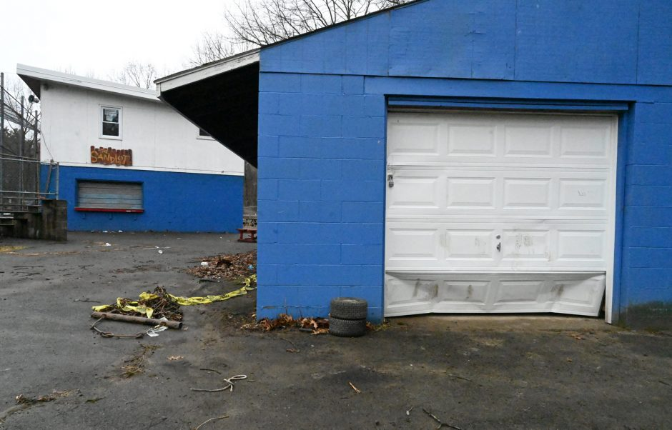 A storage garage door at Schenectady Little League is shown after being kicked in by vandals.