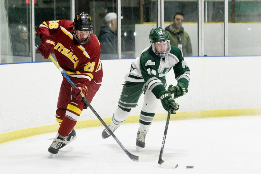Jacob Mayo of Shenendehowa carries the puck in a non-league game against Ihaca on January 18.