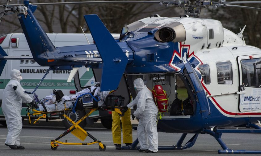 A downstate COVID-19 patient is transferred to Ellis Hospital via helicopter at Schenectady High's parking lot Sunday