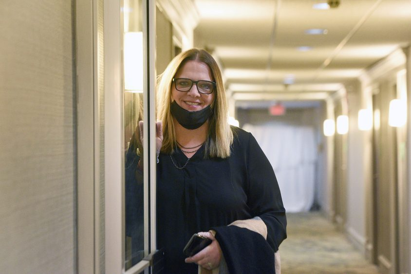 Shelters of Saratoga Executive Director Karen Gregory stands in the hallway of Holiday Inn.
