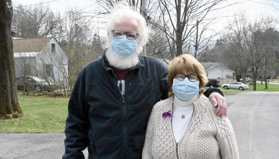 Denis Brennan, Niskayuna town historian, and his wife, Margaret, stop for a photo during their walk.