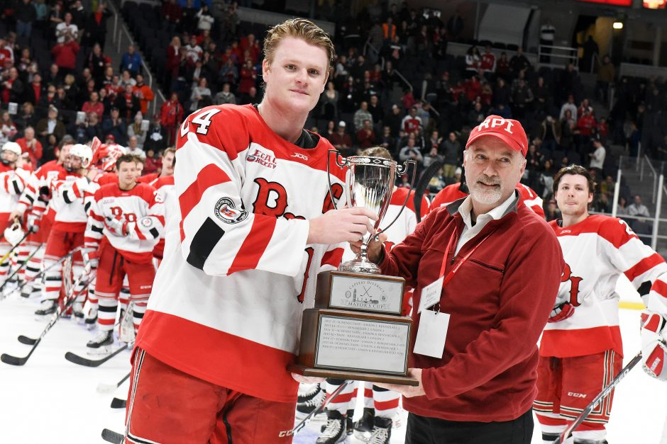 Troy Mayor Patrick Madden hands the Mayor's Cup to RPI's Will Reilly after beating Union Jan. 25 at Times Union Center.