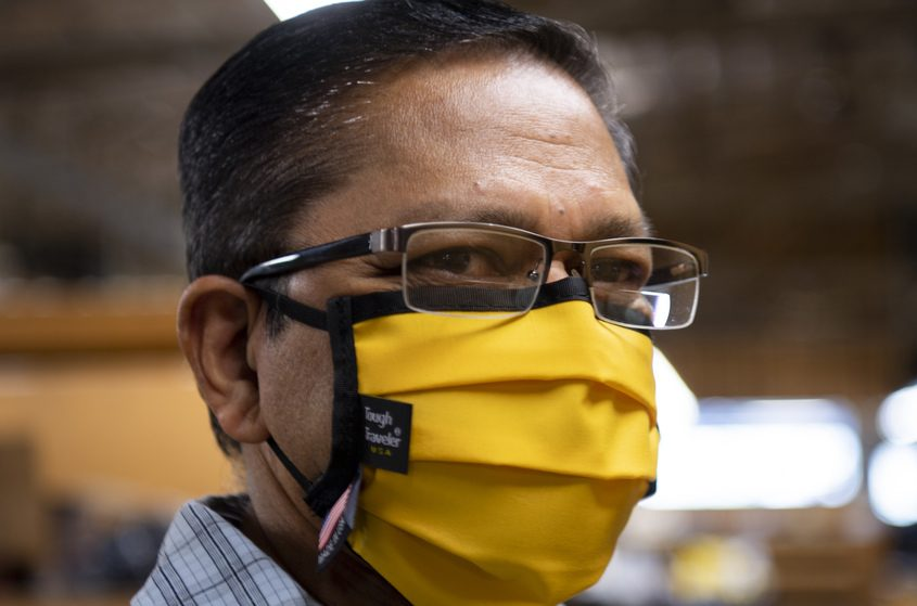 Tough Traveler worker Michael Rembersauer wears a mask made at the State Street business in Schenectady Wednesday.