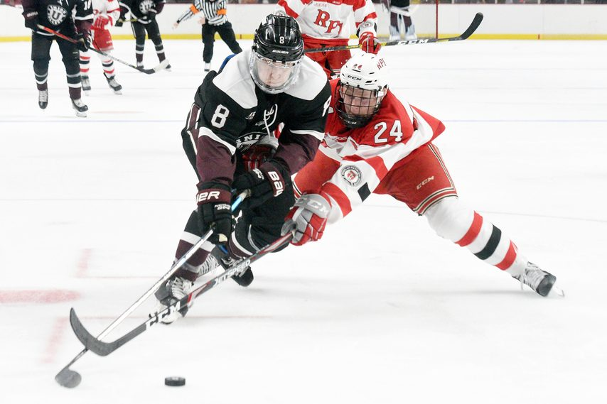 RPI's Will Reilly (24) battles for the puck with Union's Anthony Rinaldi during the Mayor's Cup in Albany.