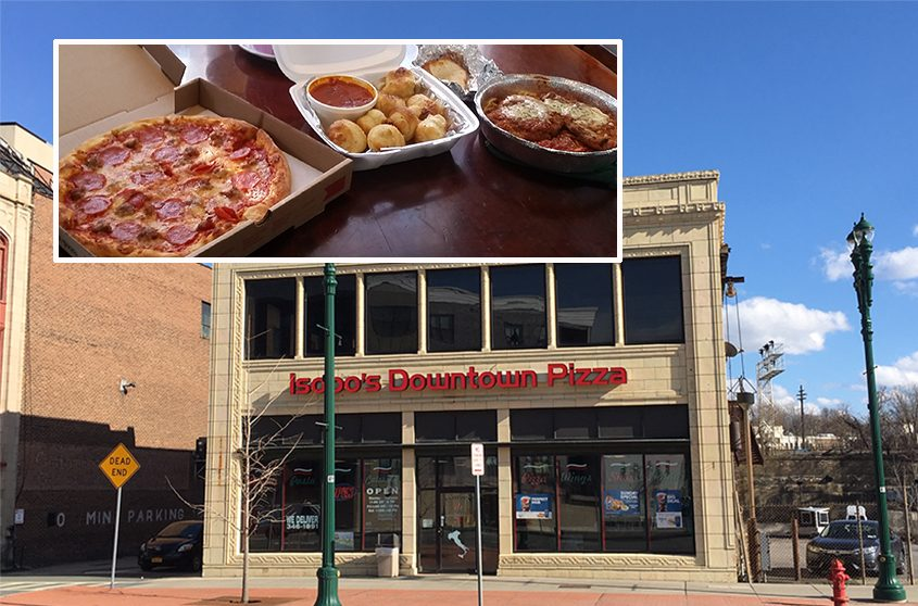 A pizza with pepperoni and sausage, garlic knots and an order of chicken parm (inset) from Isopo's Downtown Pizza,