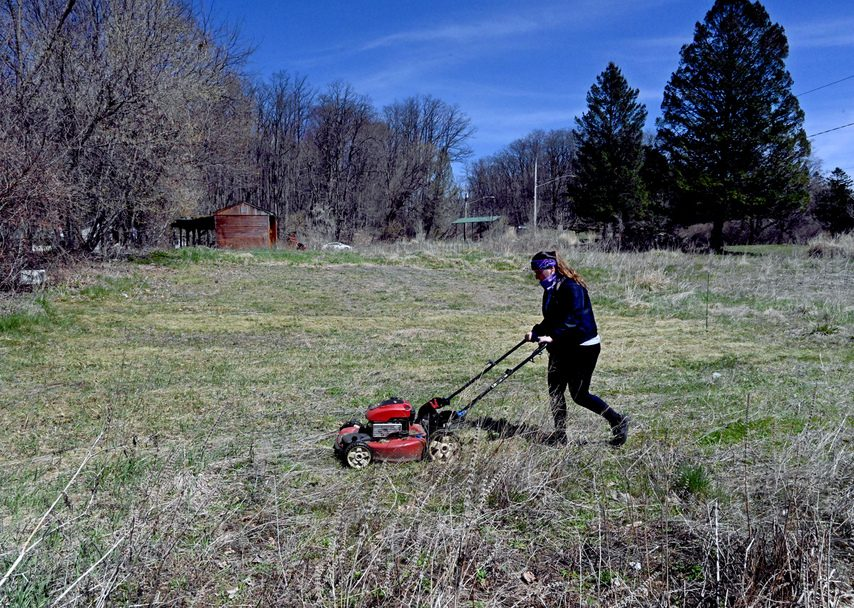 Leah Egnaczyk begins to prepare the grounds at the Schenectady Urban Farm located on Fehr Ave, near Schenectady's Central Park.
