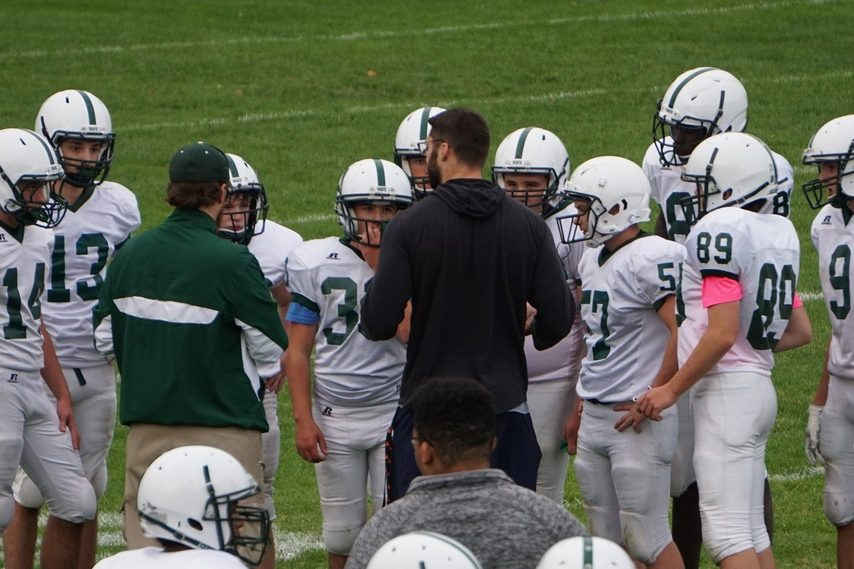 Scott Sicko (dark sweatshirt) coaches up the Dover (N.H.) High School football reserve team.