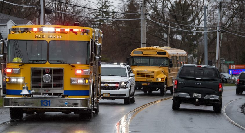 A Carman fire truck leads a parade of Mohonasen Central School District teachers in a parade earlier this month