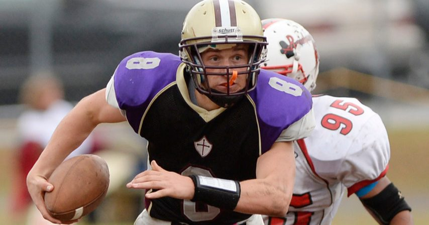 Justin Rohrwasser runs with the ball for Holy Trinity as a Catholic Central High School senior in 2014.