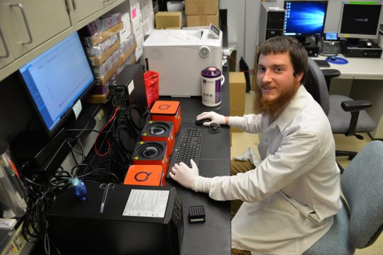 Michael Golec, a medical technologist at Albany Medical Center, works inside the hospital's molecular diagnostics lab.