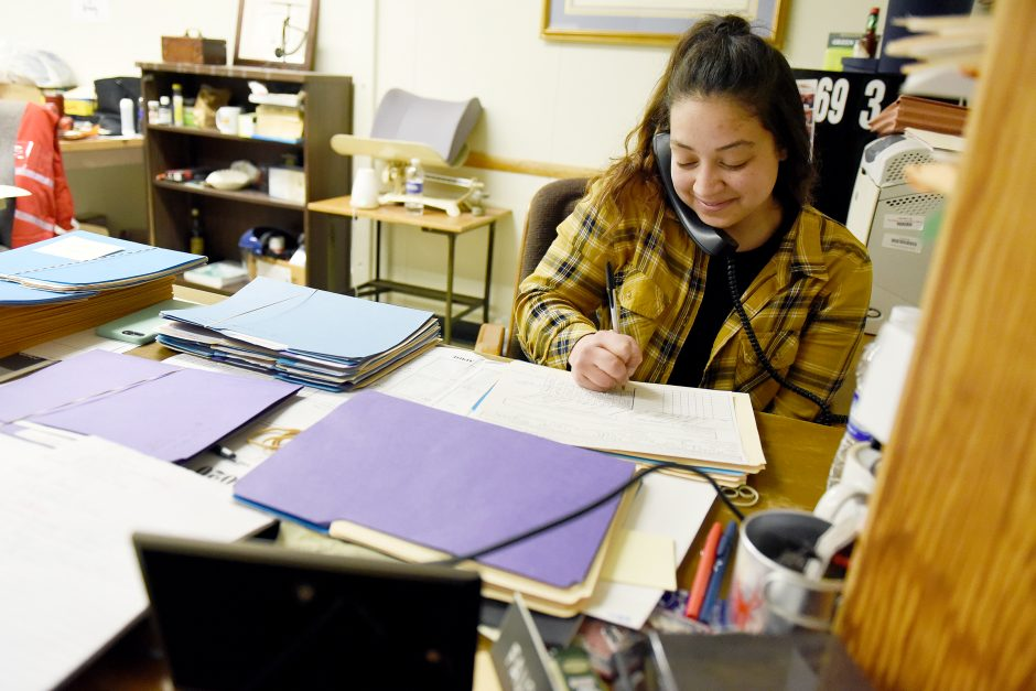 Ashley Hubbard works at her desk in the county offices, where she has been temporarily assigned to the Public Health Department.
