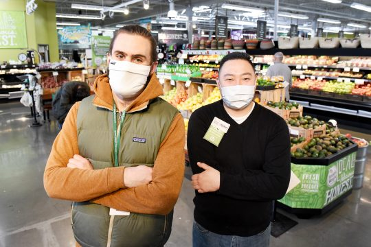 Alex Mytelka, left, and Stephen Quickenton inside Honest Weight Food Co-op in Albany on April 17.