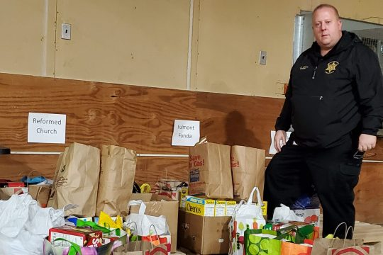 Montgomery County Sheriff Jeffery Smith helps sort food that will be delivered by him and his deputies.