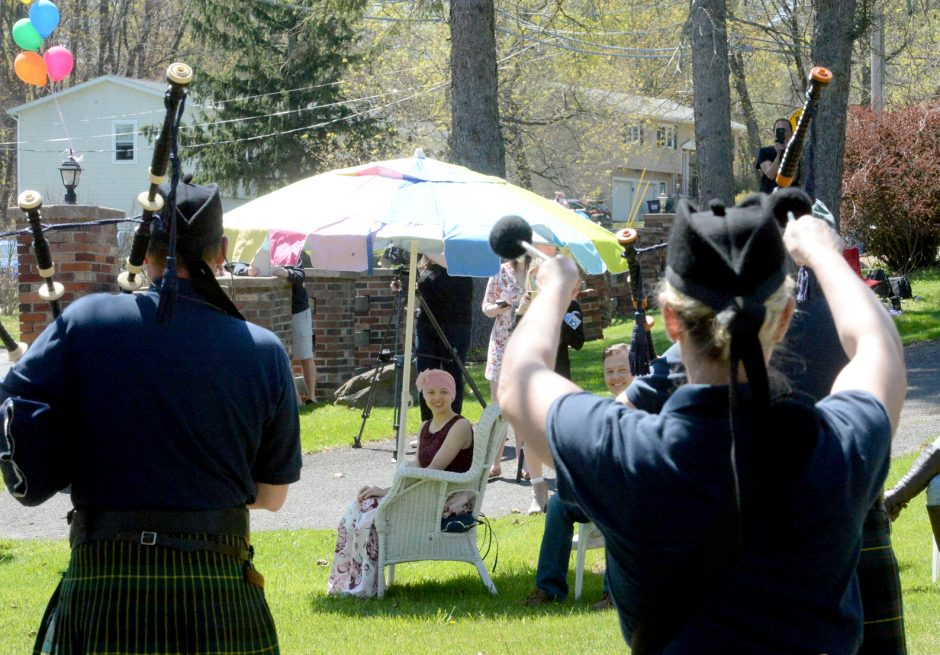 The Schenectady Pipe Band performs as Jackie Jasiewicz looks on Sunday in Colonie.