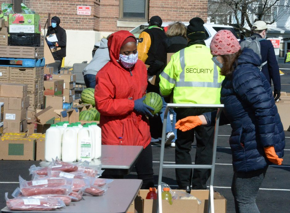 Catholic Charities of the Diocese of Albany and the Regional Food Bank of Northeastern New York distribute food boxes in Albany.