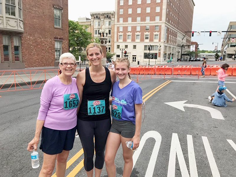 Jennifer Oertel, center, flanked by her mom, Molly, left, and daughter Emma at the 2019 Freihofer's Run for Women.