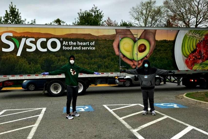 A Sysco truck behind Siena's Manny Camper, left, and Paul Tue in a recent photo.
