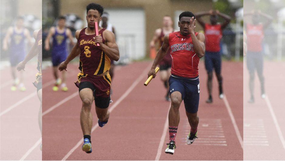 Schenectady's Trebor Davis, right, wins the 400 relay in the 2018 Eddy Meet.