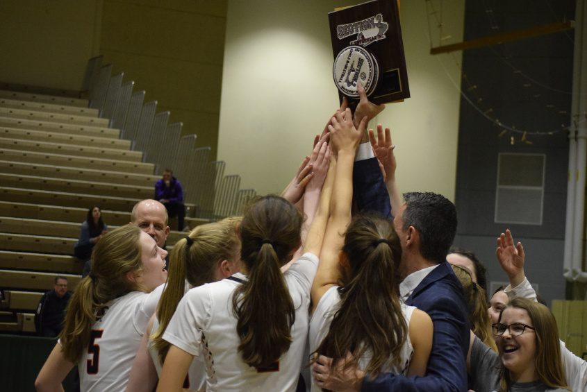 The Cambridge girls' basketball team celebrates its 2020 Section II Class C championship.