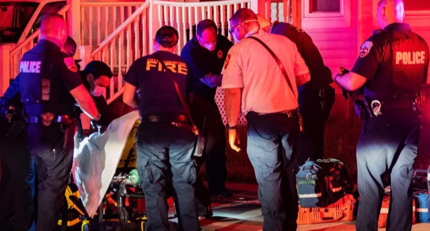 Paramedics tend to a victim at the scene Tuesday night