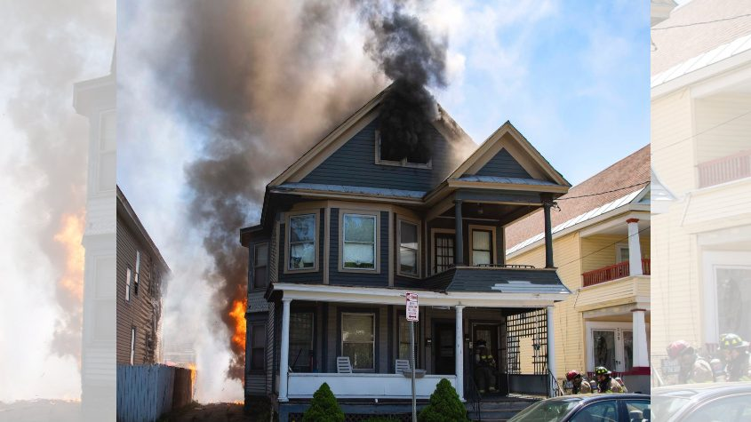 Schenectady firefighters go to work at 203 Elmer Avenue after flames were discovered shortly before noon
