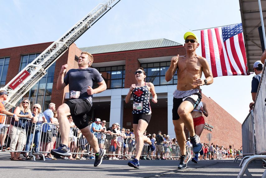 Runners head to the finish line at the 2019 Firecracker4 in Saratoga Springs.